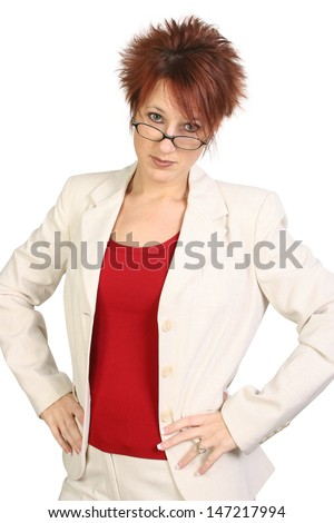 Beautiful Middle Aged business woman or teacher with stern expression.