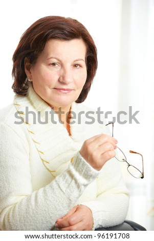 Beautiful middle aged business woman portrait at the office. - stock photo