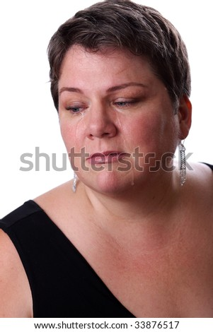 Beautiful middle aged woman crying.