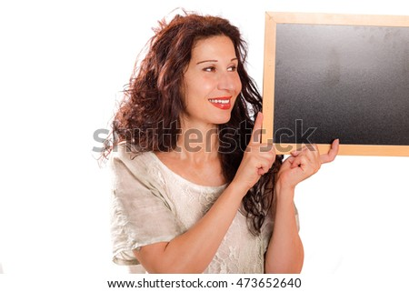 beautiful middle-aged woman holding blank black chalkboard isolated on white