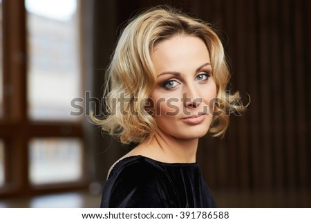 Beautiful Middle Aged Woman in her thirties  looking at camera - stock photo