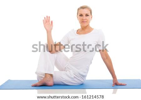 beautiful middle aged woman yoga pose on white background - stock photo