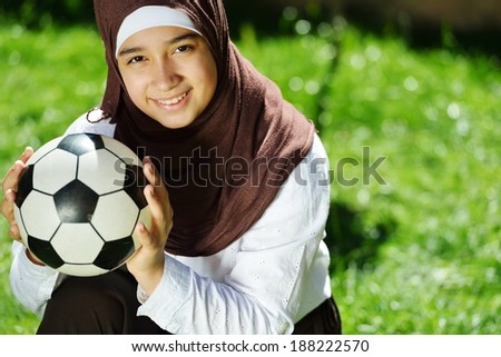 Beautiful Middle Eastern Arabic girl having fitness time in nature - stock photo