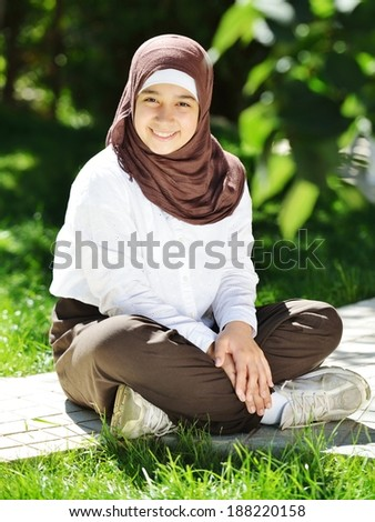 Beautiful Middle Eastern Arabic girl having happy time in nature - stock photo