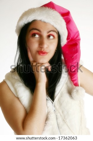 Beautiful middle eastern girl thinking about Christmas. - stock photo