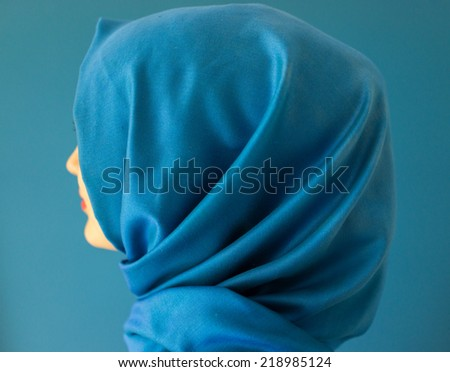 Beautiful Middle eastern girl with a scarf on red and blue - stock photo