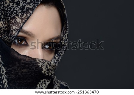 Beautiful Middle eastern woman in niqab - stock photo