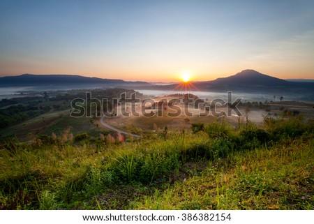 Beautiful misty morning sunrise in Khao Takhian Ngo View Point at Khao-kho Phetchabun,Thailand - stock photo