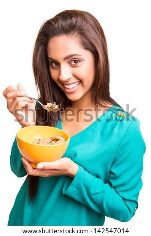 beautiful mix race woman eating cereals - stock photo