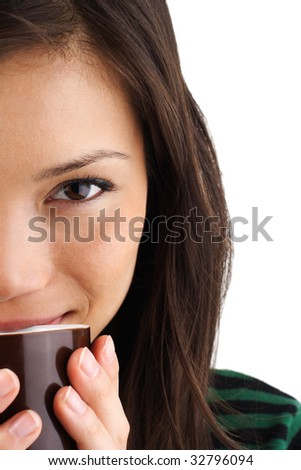 Beautiful mixed asian / caucasian woman drinking coffee or tea - stock photo