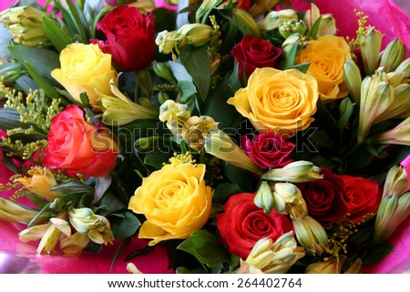 Beautiful mixed, colorful, bouquet of flowers including roses. - stock photo