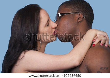 Beautiful mixed couple in loving embrace - stock photo