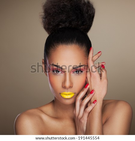 Beautiful mixed race african Woman. Modern makeup and hairstyle  - stock photo