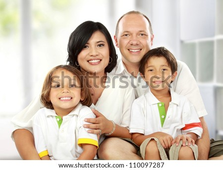 Beautiful mixed race family in the living room