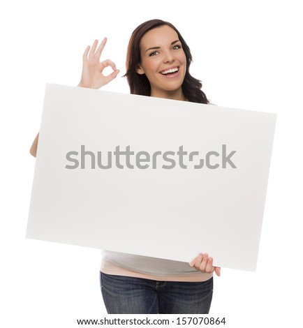 Beautiful Mixed Race Female Holding Blank Sign Isolated on a White Background Giving OK Gesture.  - stock photo