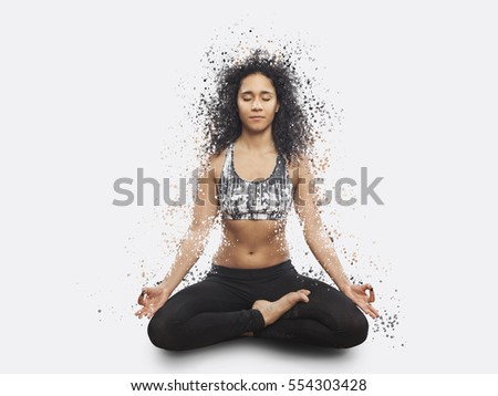 beautiful mixed race woman meditating in yoga lotus position, dispertion effect