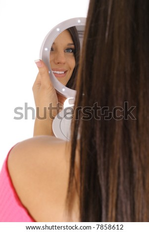 beautiful model checking her makeup - stock photo