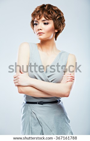 Beautiful model fashion  posing in studio against isolated gray background. Fashion snapshot style female portrait.