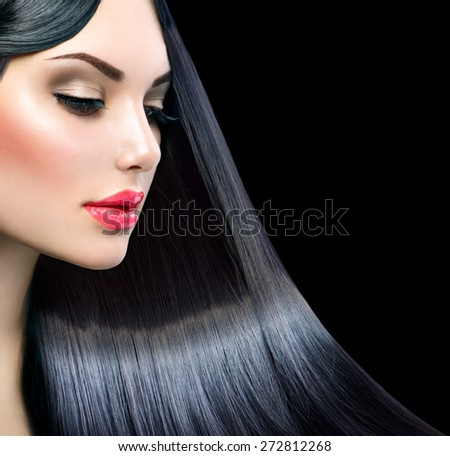 Beautiful model girl with healthy long straight shiny hair isolated on black background. Hair. Healthy Long Black Hair. Beauty Brunette Woman. Gorgeous Hair