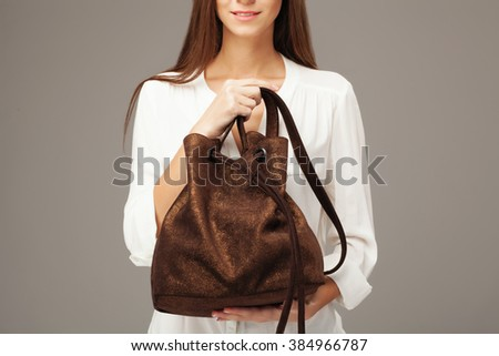 Beautiful model holding fashion bag. No-face picture