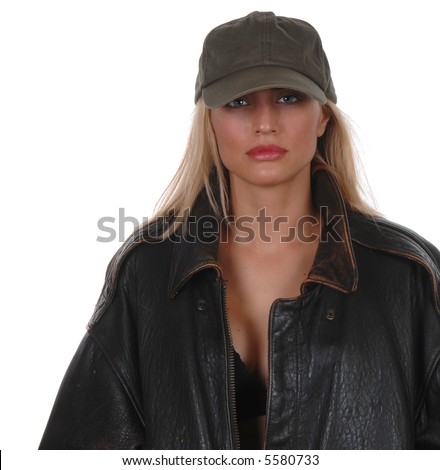 Beautiful model looking tough in brown leather jacket with baseball cap