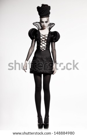 beautiful model posing as chess queen - fashion shoot - stock photo
