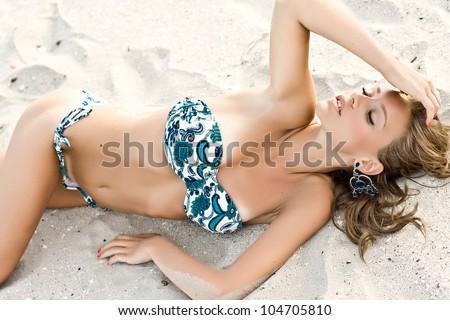 Beautiful model posing fashion on a beach - stock photo