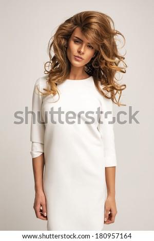 Beautiful model posing in white dress - stock photo