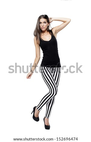 Beautiful model posing on white, leg up, isolated - stock photo