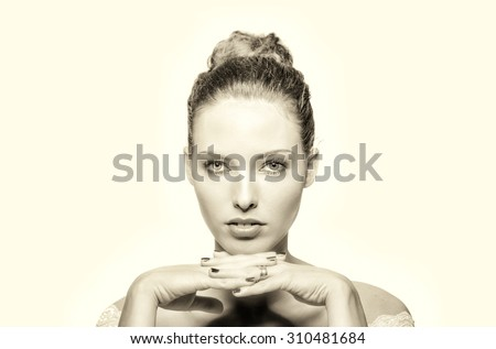 Beautiful model posing with hands under her chin. Isolated on white. - stock photo