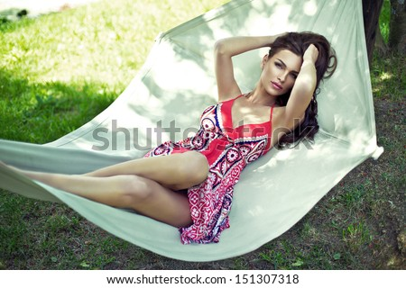 Beautiful model resting on hammock - stock photo
