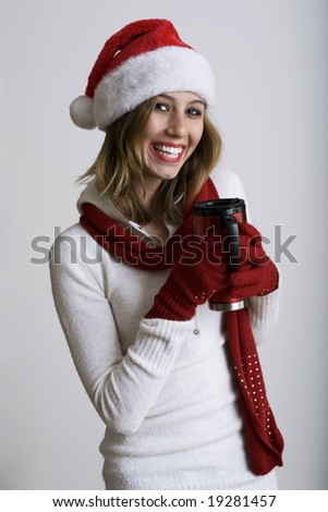 Beautiful model smiling holding a thermos - stock photo