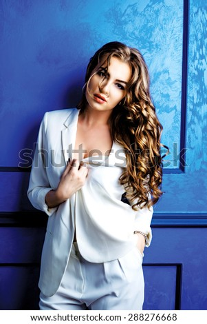 beautiful model with amazing long hair wearing a white suit - stock photo