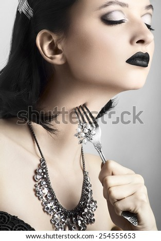 beautiful model with black lips and jewels