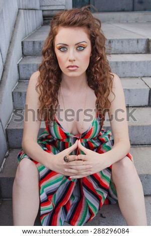 Beautiful Model With Blue Eyes and Wavy Hair - stock photo