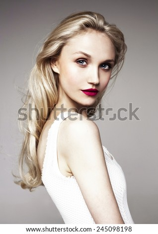 beautiful model with bright make-up (red lips) and blond hair   - stock photo