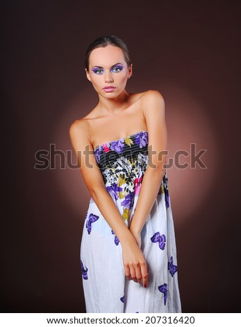Beautiful model with colorful make-up - stock photo