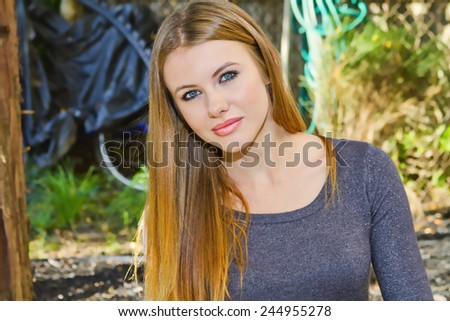 Beautiful Model with Natural Makeup and With Her Long Blonde Hair - stock photo