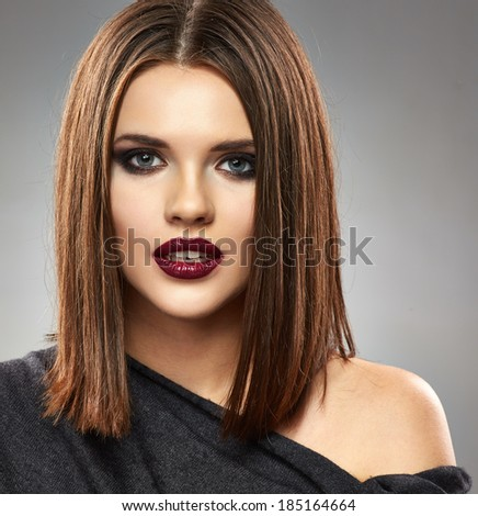 Beautiful model with straight Hair Style. Red lips. Beauty face portrait.