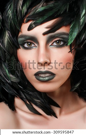 Beautiful model woman face closeup. Mysterious girl portrait