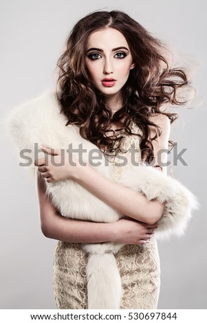 Beautiful Model Woman with Long Brown Hair and Luxurious Dress