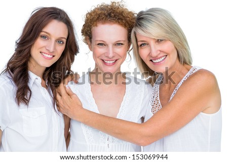 Beautiful models posing hugging each other on white background - stock photo