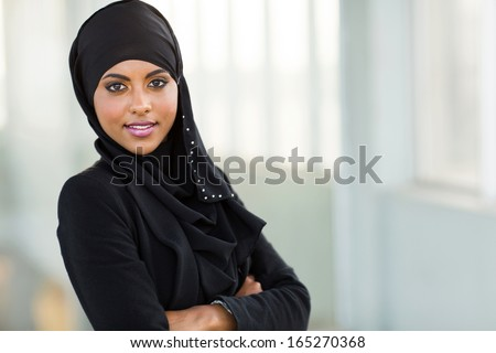 beautiful modern arabic office worker portrait with arms crossed - stock photo