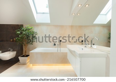 Beautiful modern bathroom with big illuminated bathtube - stock photo