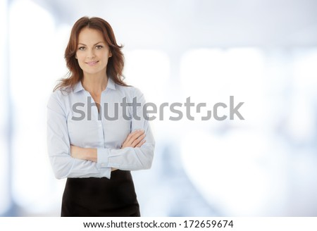 Beautiful modern businesswoman standing in her office. - stock photo