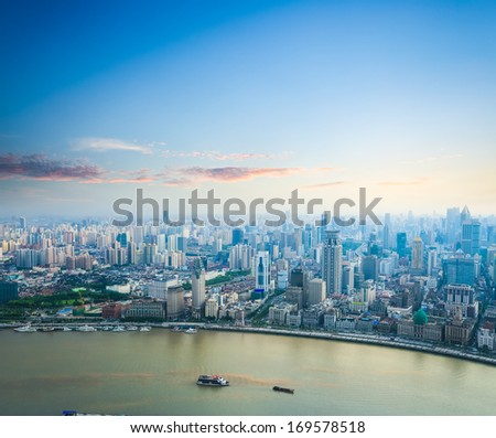 beautiful modern city skyline in sunset aerial view of shanghai the bund and huangpu river  - stock photo