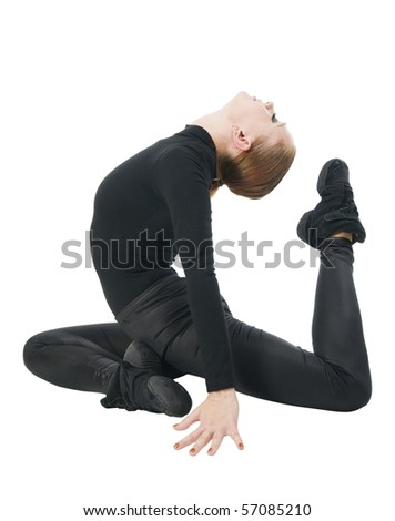 Beautiful modern dancer wearing black on white background