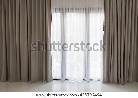 Beautiful modern grey and white curtains in living room