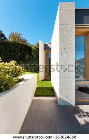 beautiful modern house in cement, detail veranda - stock photo