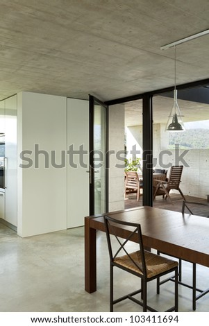 beautiful modern house in cement, interior, dining table, detail - stock photo